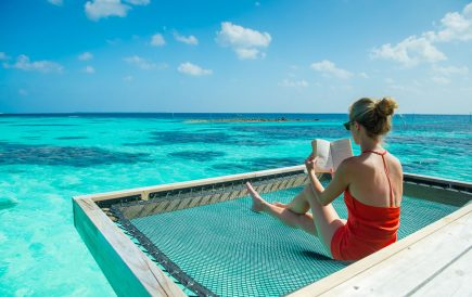 Luxury pool woman with book