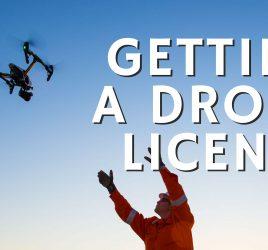 man flying drone blue sky